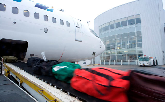 Photo of luggage being loaded onto an airplane