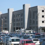 Photos of cars parked at the airport with the parkade in the background thumbnail
