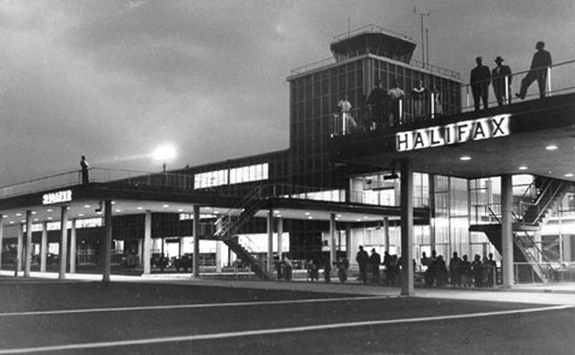1960's photo of the entrance to the terminal building at night